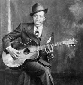 http://www.americanbluesscene.com/wp-content/uploads/2011/08/Robert-Johnson-292x300.jpg