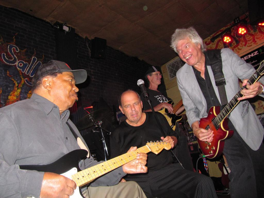 Matt Murphy trades licks with Cliff Goodwin and David Foster in the middle