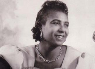 Memphis Minnie flashes her gold teeth in Chicago, circa 1938. Photographer unknown, courtesy Delta Haze Corporation